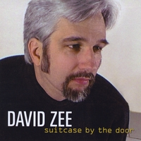 David Zee | Suitcase By the Door