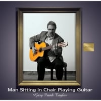 Gary Frank Taylor | Man Sitting in Chair Playing Guitar